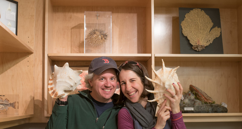 Liz and Jon at a museum holding shells.