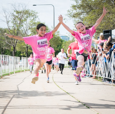 Girls jumping at Girls on the Run 5k.