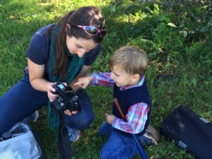 Liz teaches a young aspiring photographer.