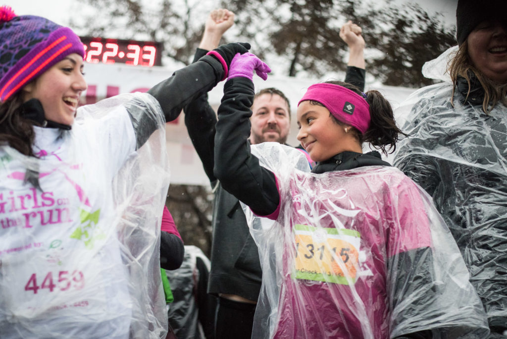 Girls on the Run Chicago high fives at finish line