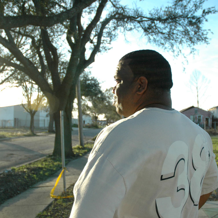 Resident of the Lower Ninth Ward of New Orleans stares into the setting sun.